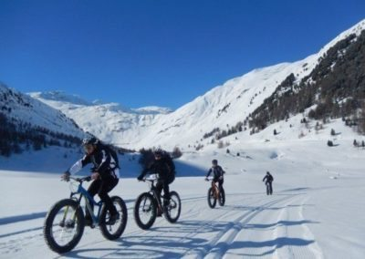 Fat bike or snow bike, an ideal bike for a ride along the snowy mountains of the Dolomites.