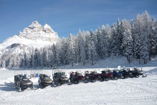 Snowmobile Misurina Dolomite mountains