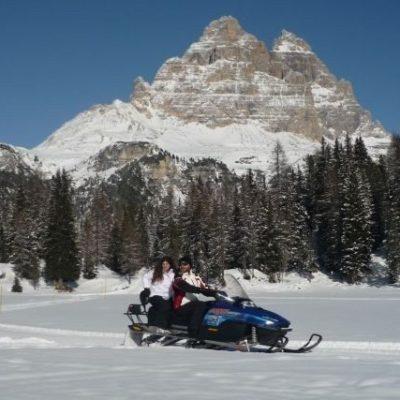 Snowmobile Misurina lake dolomites
