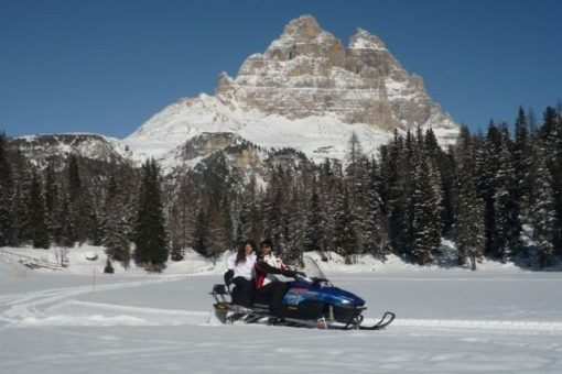 Snowmobile Misurina lake dolomites