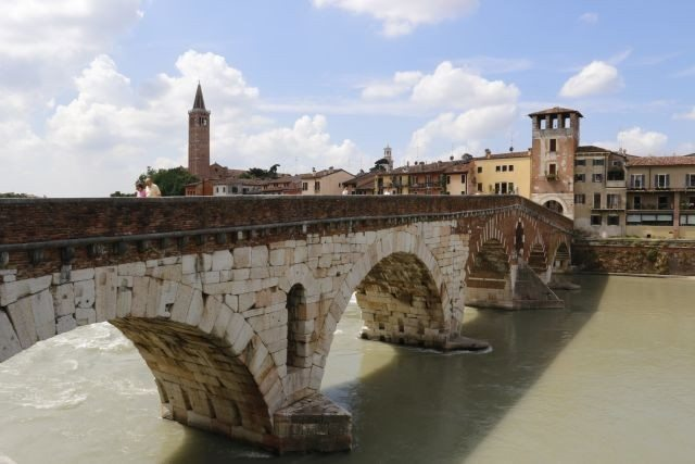 Verona art city, stone bridge on the Adige river, Veneto region. To visit during a day excursion with professional driver