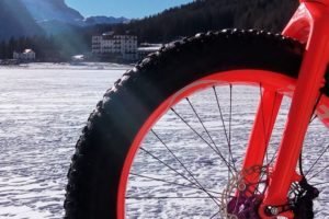 Fat bike Misurina Dolomite mountains, day tour in an outdoor activity nature excursion. to discover an environment that is intact