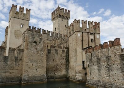 Scaliger castle Sirmione medieval town Garda lake, port fortification of the middle ages. It presents the typical Ghibelline swallowtail merlons.Day tour wiht Sightseeing in Italy