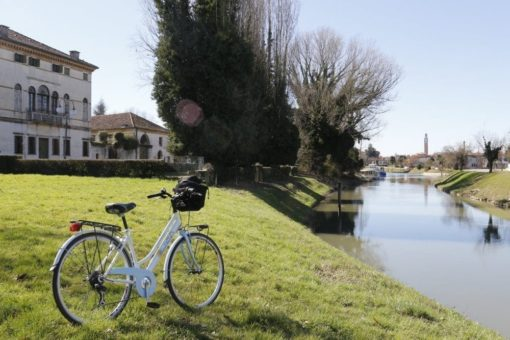 Bicycle ride Mira Brenta canal day excursion, during a visit of Venetian villas between Padua and Venice. Sightseeing in Italy