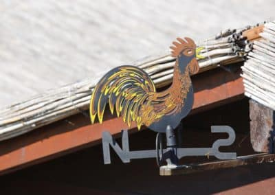 Rooster weathervane metalworking craft in the Veneto region, Italy. Visit during a themed day excursion with professional driver. Sightseeing in Italy