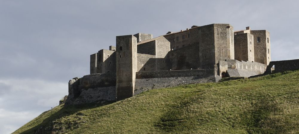 Melfi castle medieval town Basilicata Italy, important city walls in southern Italy. the Swabian and Angevin walls were further extended by the Aragonese feudataries Caracciolo and enhanced to make it resistant to new fire weapons, like the bombards and mines.